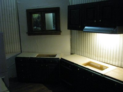 Kitchen with window and cabinets roughed